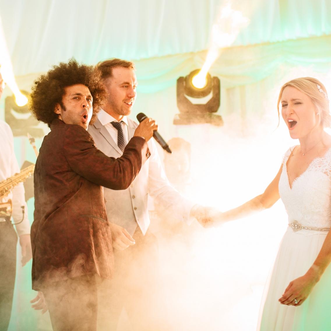 bride and groom singing at their wedding