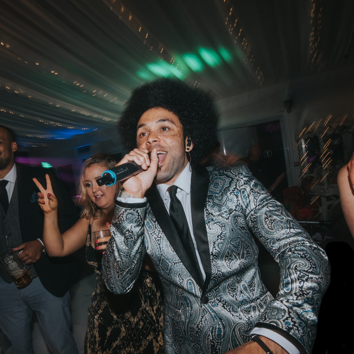Lead singer dancing in crowd at wedding