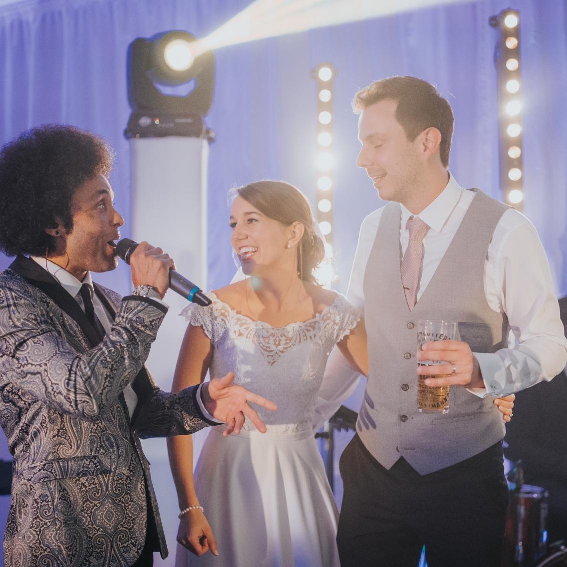 Bride and Groom singing at wedding Parklands Quendon Hall